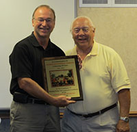 Jerry Foellmi Receives Recognition Plaque from PSCA