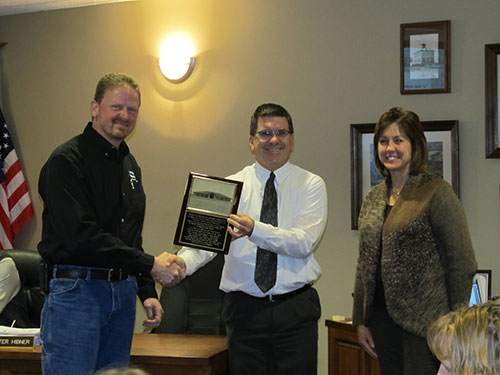 GEC's Kent Fish & Jolene O'Brion Present Dedication Plaque to Portage Community School District Board