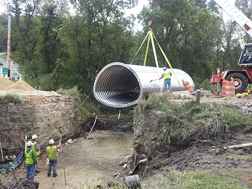 Aluminum Culvert Lowered in to Place